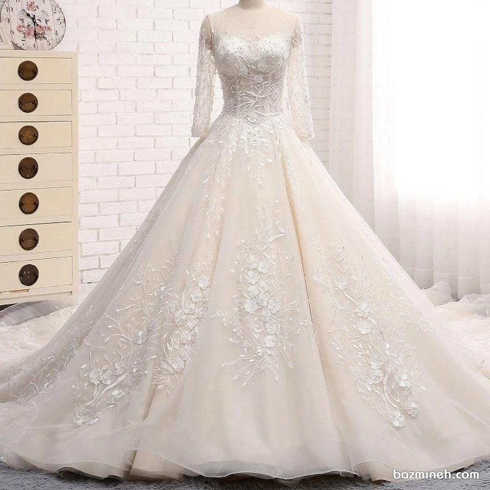 لباس عروس پوشیده آستین توری با گل های برججسته کار شده در دامن