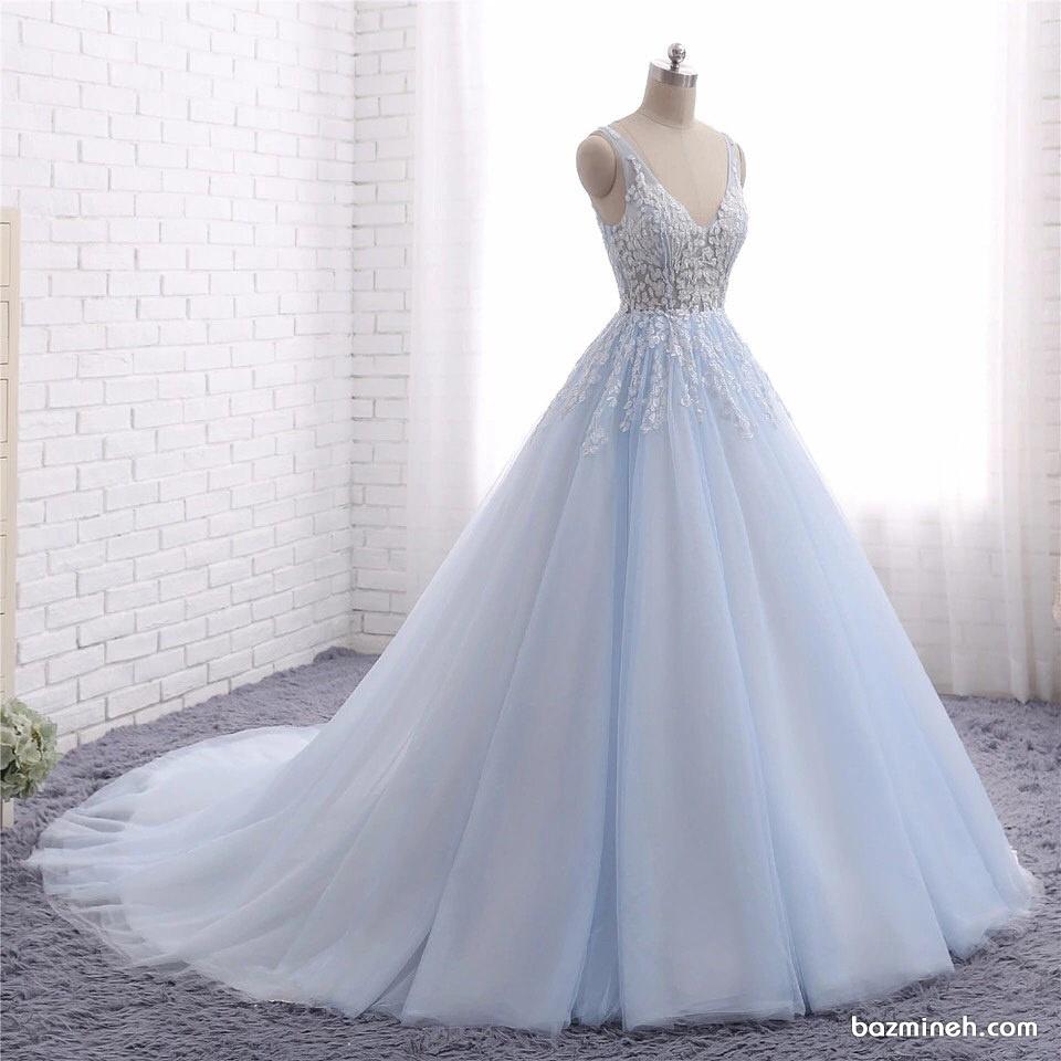 لباس نامزدی با دامن پفی دنباله دار به رنگ آبی روشن