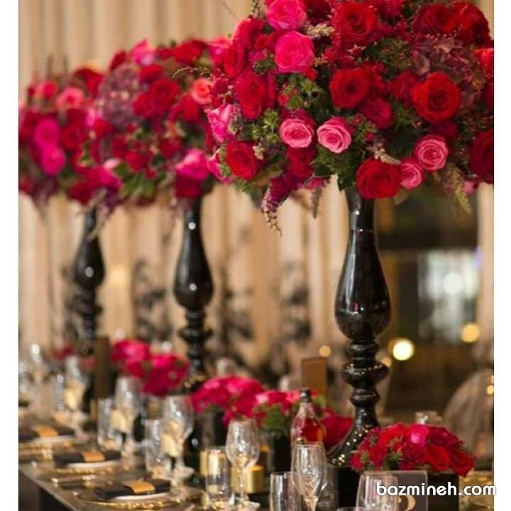 گل آرایی میز پذیرایی مجالس باشکوه با گل های رز قرمز