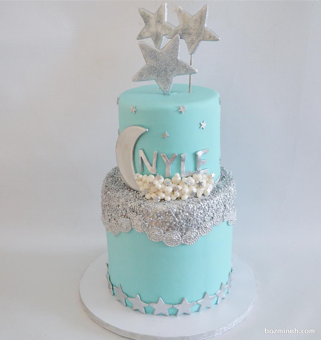 کیک آبی نقره ای جشن بیبی شاور با تم ماه و ستاره