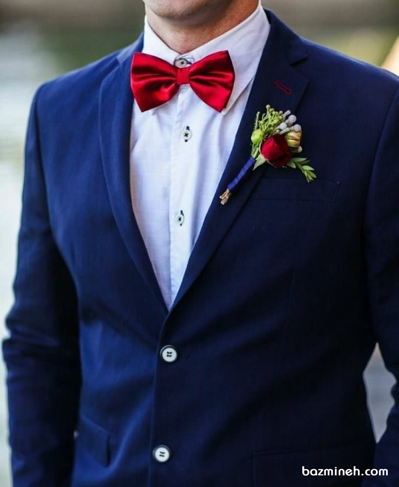 کت تک سورمه ای همراه با پیراهن سفید و پاپیون قرمز ست جالبی برای مراسم خواستگاری یا نامزدی