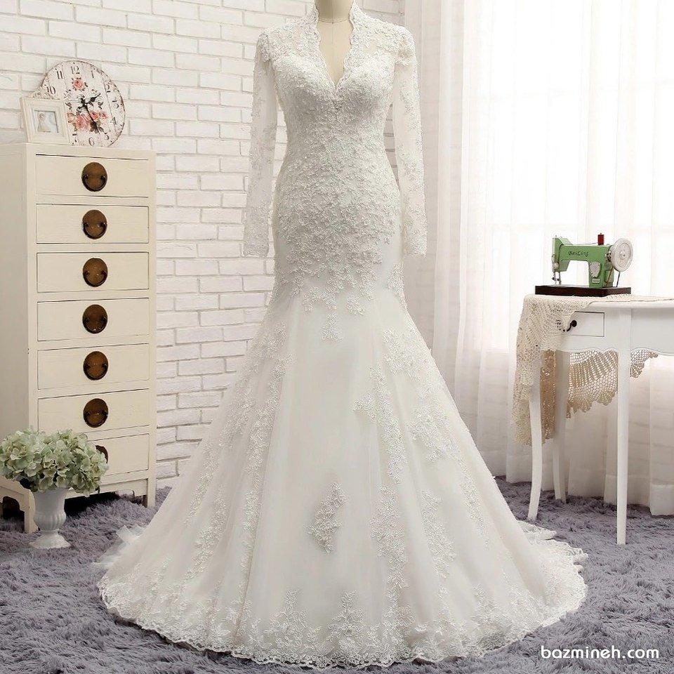 لباس عروس ساده و شیک پوشیده آستین دار با دامن مدل ماهی کارشده
