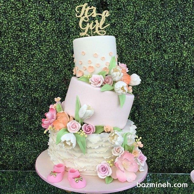 کیک فانتزی جشن بیبی شاور دخترانه تزئین شده با گل های رنگی