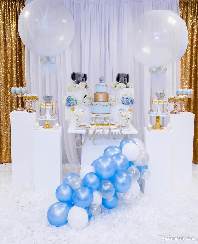 دکوراسیون شیک جشن بیبی شاور پسرانه با تم سفید آبی طلایی