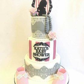 کیک فانتزی جشن بیبی شاور دخترانه با تم طوسی صورتی