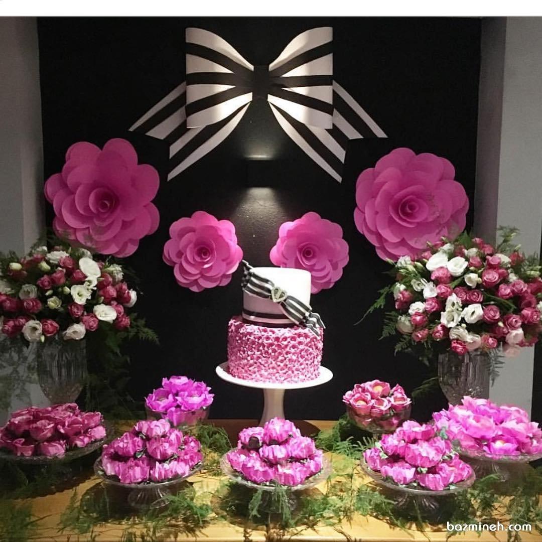 دکوراسیون زیبای جشن تولد دخترانه با تم صورتی مشکی و ایده درست کردن گل های کاغذی برای تزیین