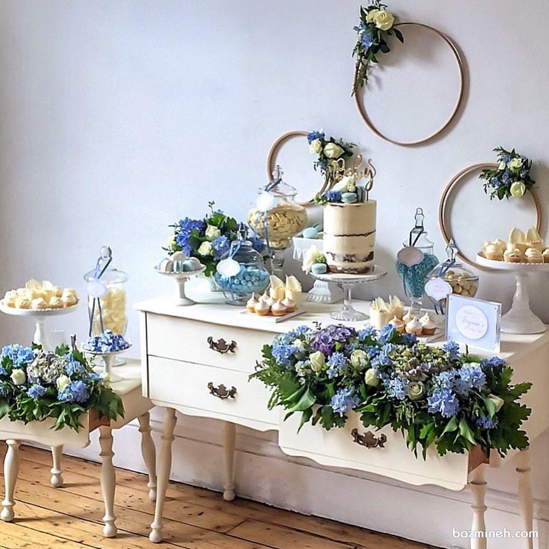 دکوراسیون شیک و زیبای جشن بیبی شاور پسرانه با تم سفید آبی همراه با گل آرایی