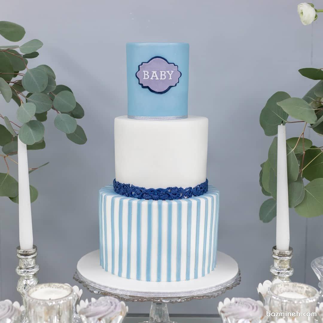 کیک چند طبقه جشن بیبی شاور پسرانه با تم سفید آبی
