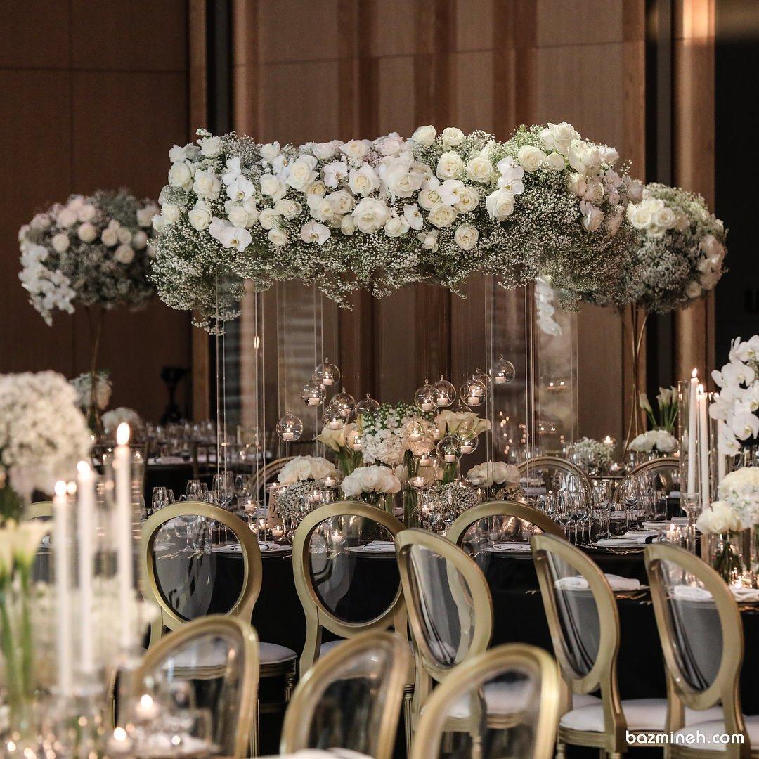 دکوراسیون باشکوه جشن عروسی با رزهای سفید و حباب های شیشه ای
