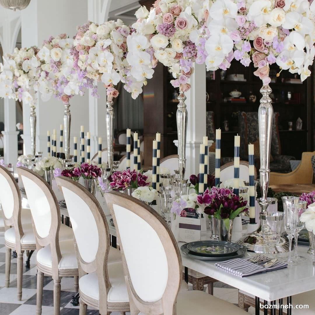 دکوراسیون باشکوه میز پذیرایی جشن عروسی با گل های رز و ارکیده