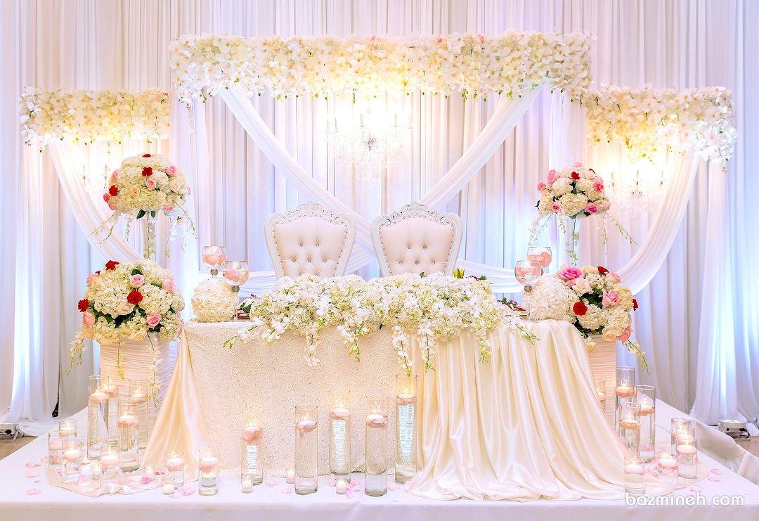 گل آرایی و شمع آرایی زیبای جایگاه عروس و داماد در تالار