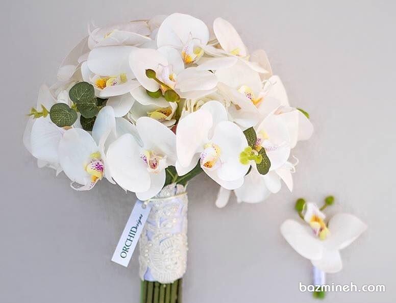 دسته گل زیبا و کلاسیک عروس با ارکیده های سفید