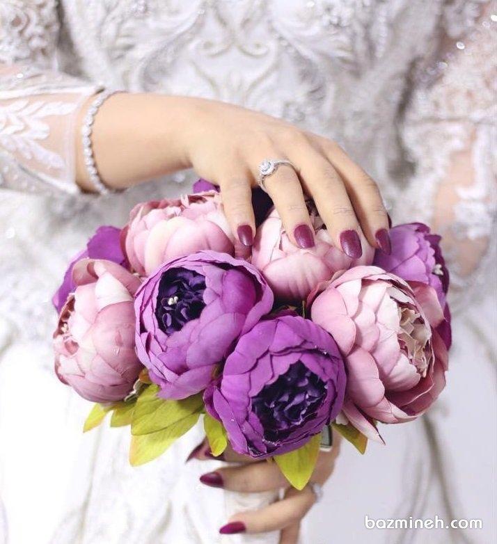 دسته گل زیبا و خاص با گلهای بنفش مناسب استایل لاکچری