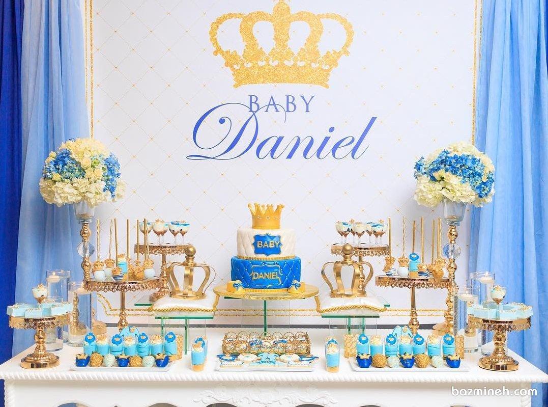 دیزاین میز پذیرایی جشن بیبی شاور پسرانه با تم آبی طلایی
