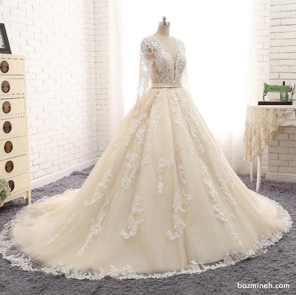 لباس عروس نباتی رنگ پوشیده آستین دار با دامن دنباله دار
