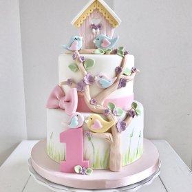 کیک فوندانت جشن تولد یکسالگی دخترانه با تم پرنده صورتی و آبی