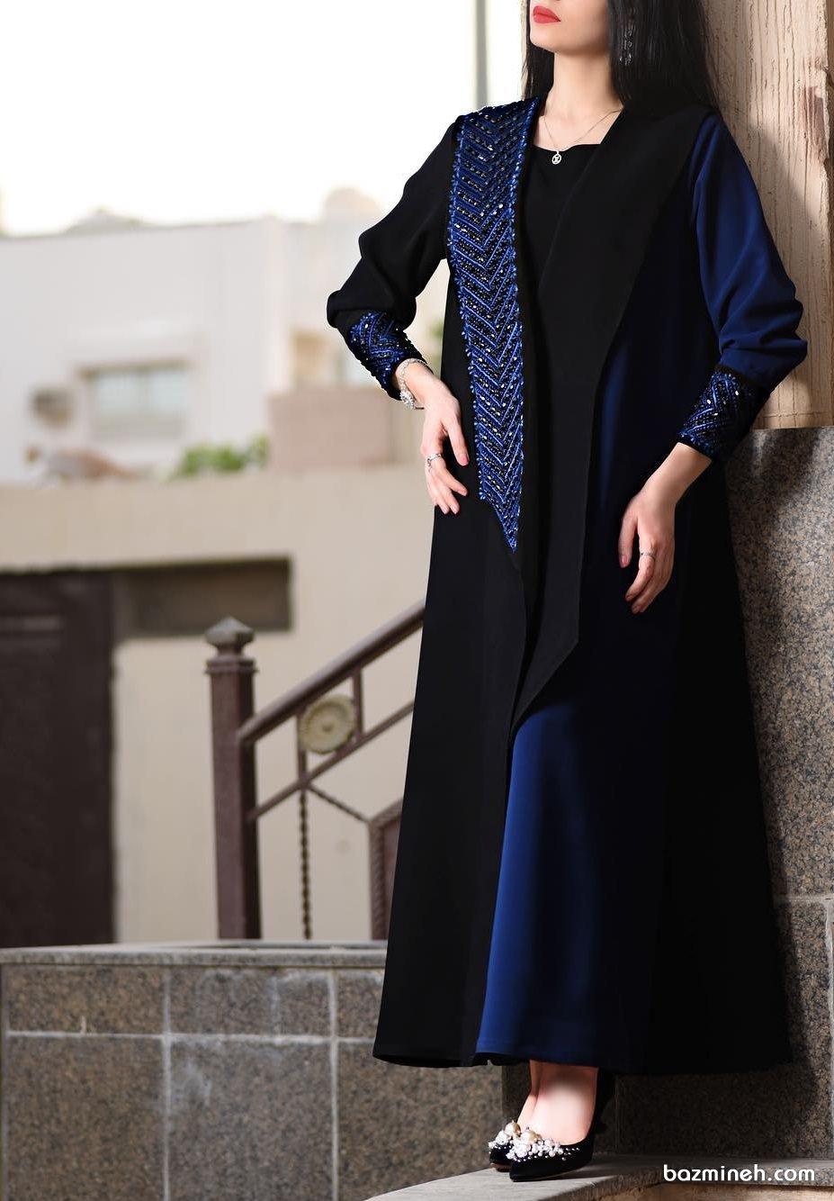 مانتو جلو باز کرپ دو رنگ مشکی سورمه ای سنگدوزی شده مناسب برای شرکت در مجالس رسمی