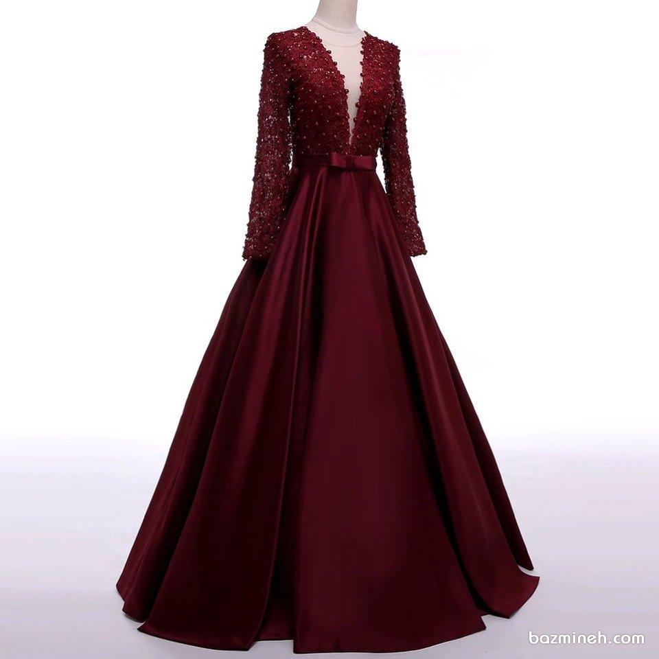 لباس مجلسی زنانه زرشکی رنگ با بالا تنه گیپور مروارید دوزی شده و دامن ساتن کلوش مناسب برای ساقدوش های عروس