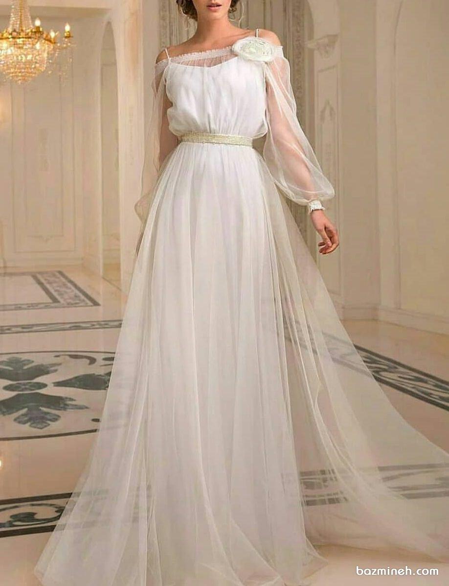 پیراهن ساده و شیک سفید رنگ توری با آستین های پفی مناسب برای عروس خانم ها در مراسم فرمالیته یا ساقدوش ها