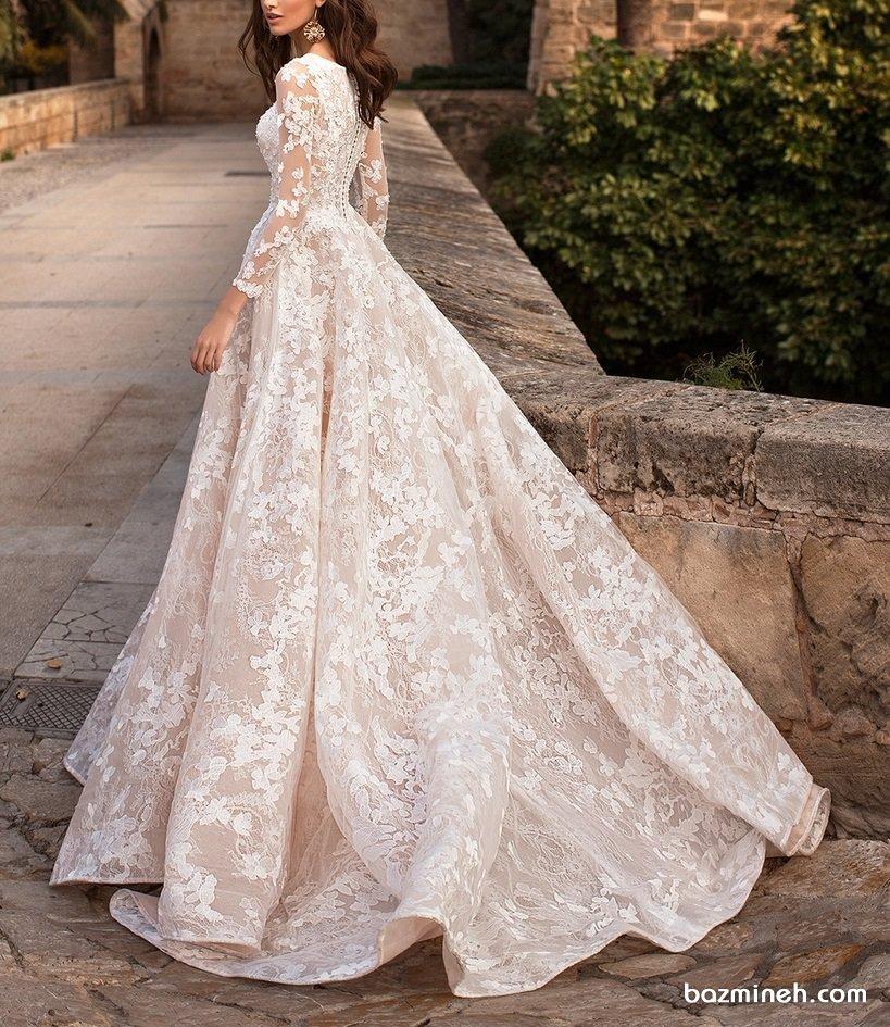 لباس عروس شیک و پوشیده آستین دار با دامن کلوش دنباله دار مدلی زیبا برای عروس خانم های لاغر اندام