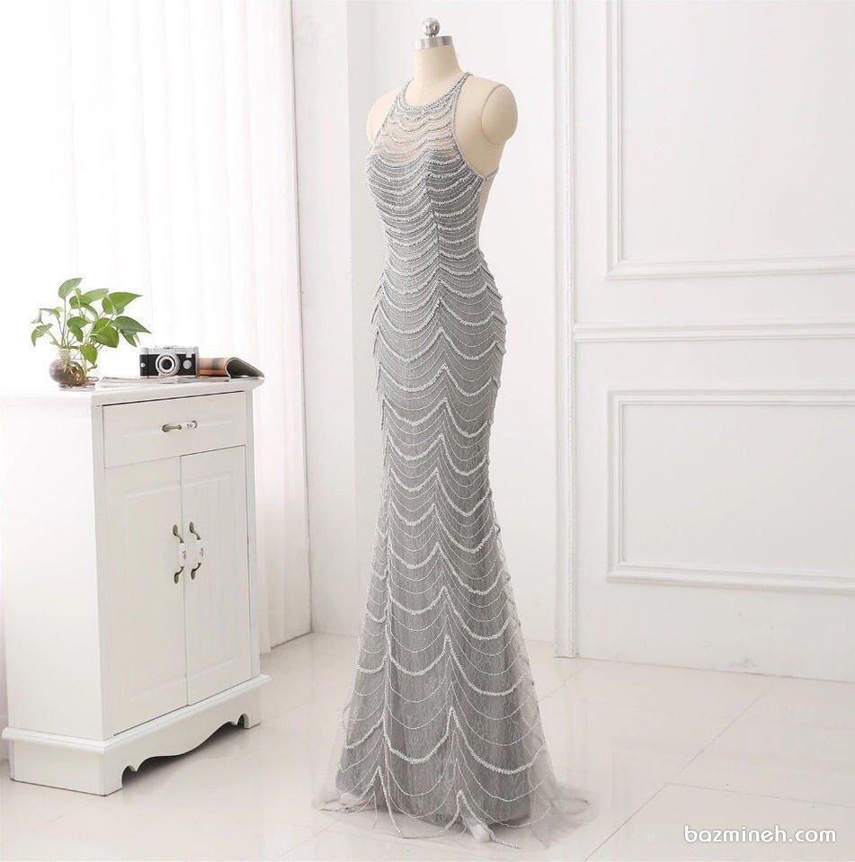 لباس مجلسی ماکسی با پارچه نقره ای مروارید دوزی شده مدلی شیک و زیبا برای ساقدوش های عروس