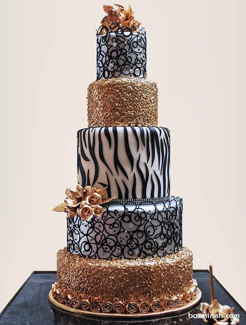 کیک منحصر به فرد جشن نامزدی یا سالگرد ازدواج با تم سفید مشکی طلایی