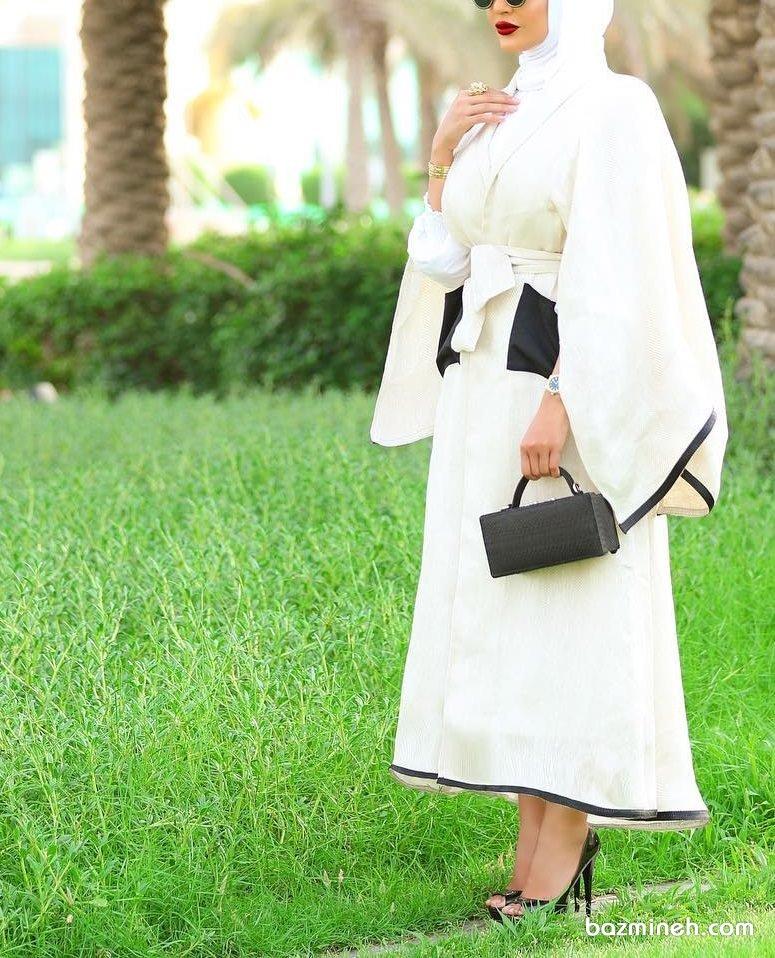 مانتو عقد بلند کرم رنگ مدل چپ و راستی با آستین های مدل دار مناسب برای مراسم عقد محضری