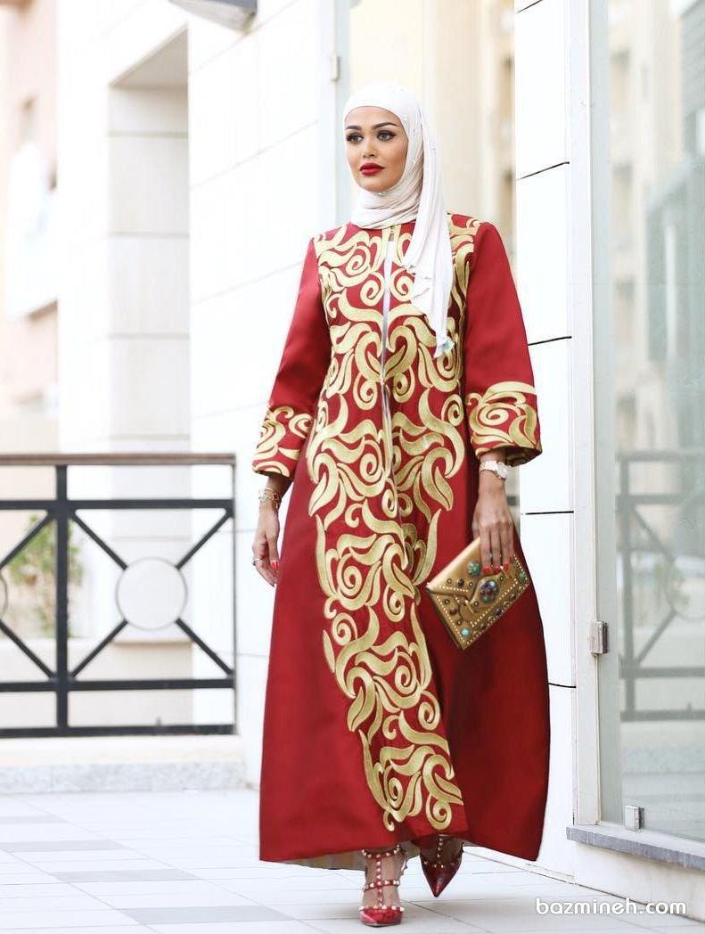 مدل خاص و منحصر به فرد مانتو عقد بلند با آستین سه ربع و پارچه طرح دار قرمز رنگ