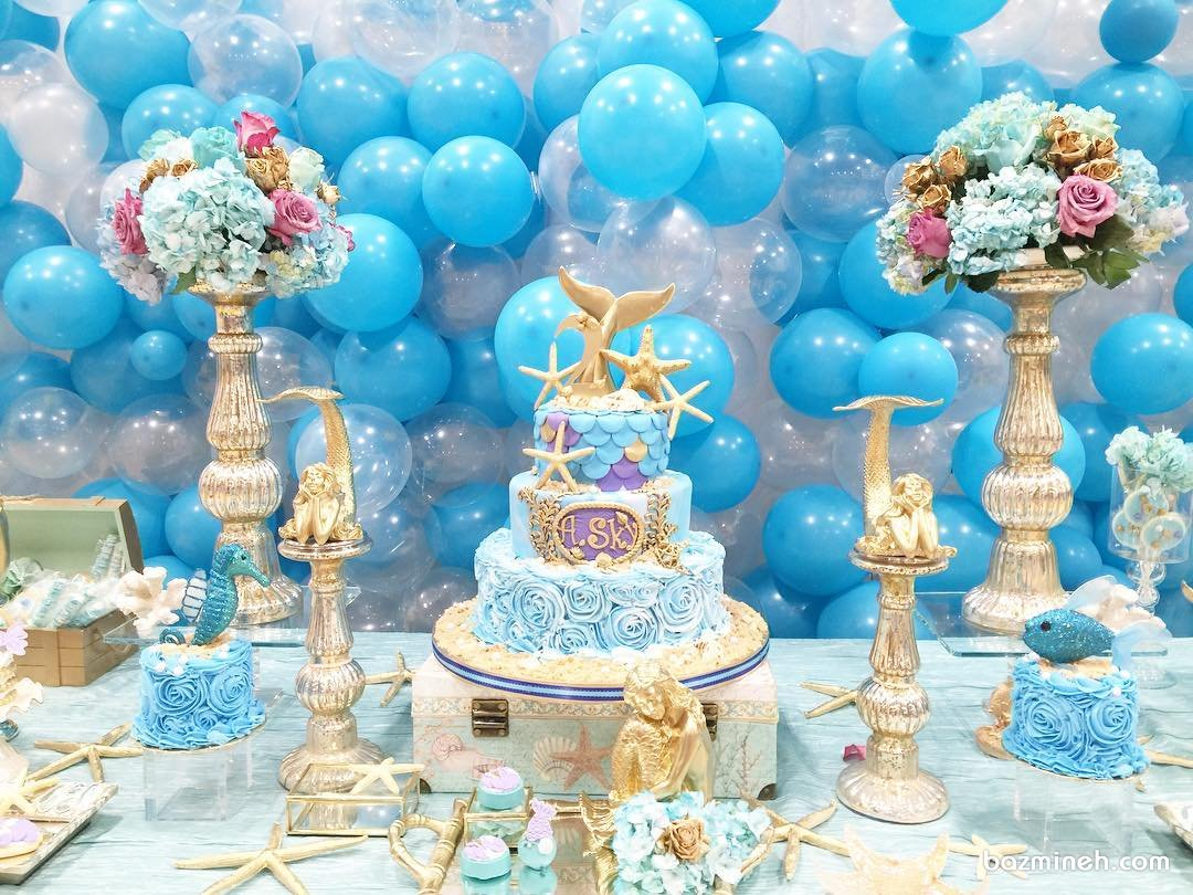 دکوراسیون رویایی جشن تولد دخترونه با تم پری دریایی و ستاره دریایی آبی طلایی