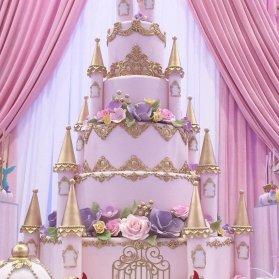 کیک چند طبقه باشکوه و رویایی جشن تولد دخترونه با تم قلعه