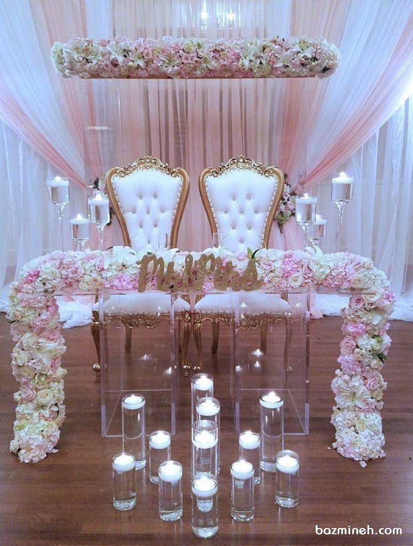 گل آرایی و شمع آرایی ساده و شیک جایگاه عروس و داماد در مجالس نامزدی و عروسی