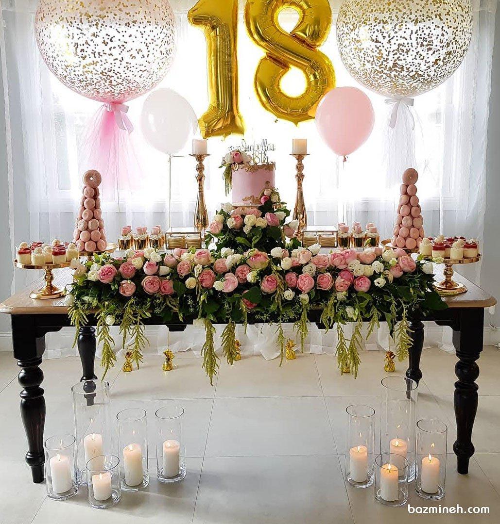 دکوراسیون و بادکنک آرایی جشن تولد نوجوان با تم صورتی طلایی همراه با گل آرایی گل های رز طبیعی و شمع آرایی