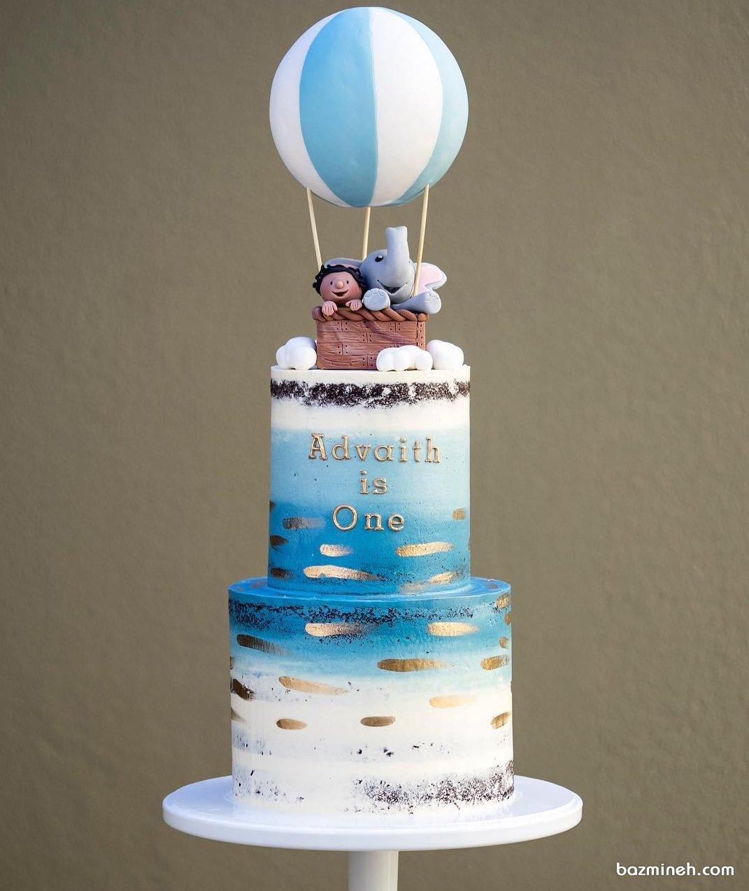 کیک دو طبقه جشن تولد پسرونه با تم بالن و فیل کوچولو آبی سفید