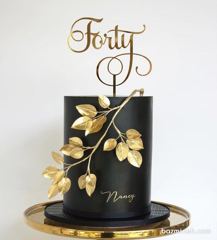 کیک فوندانت جشن تولد بزرگسال با تم مشکی طلایی