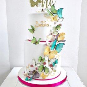کیک فانتزی جشن تولد یکسالگی دخترونه با تزیین پروانه های رنگی