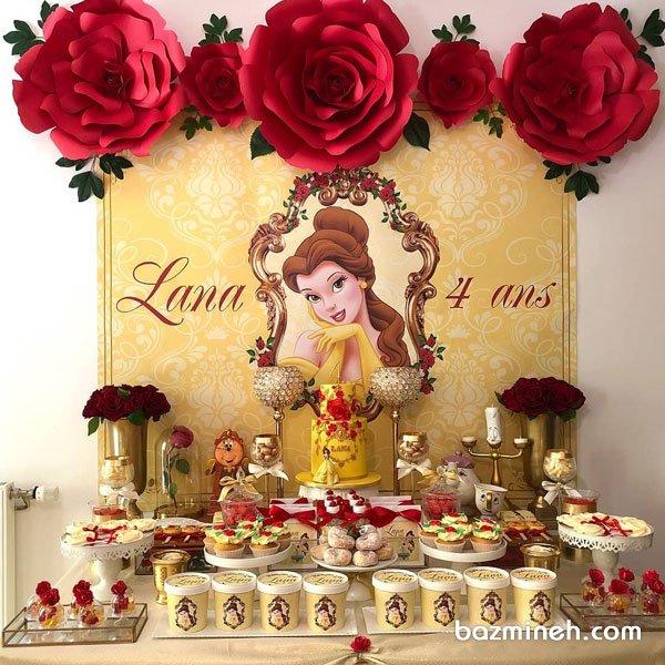 دکوراسیون شیک جشن تولد دخترونه با تم دیو و دلبر همراه با تزیینات گلهای کاغذی قرمز رنگ