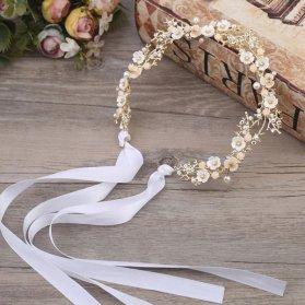 هدبند طلایی زیبا و ظریف گلدار مناسب برای شینیون های باز