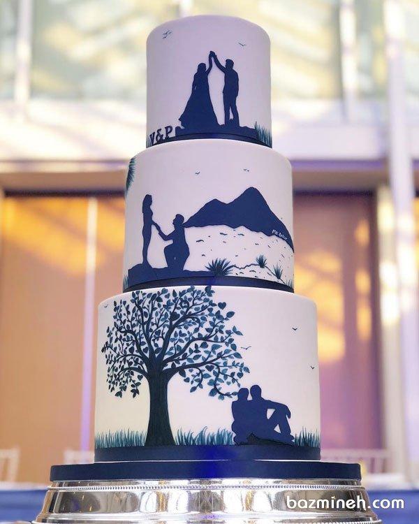 کیک چند طبقه خلاقانه جشن سالگرد ازدواج با تم سفید سورمه ای