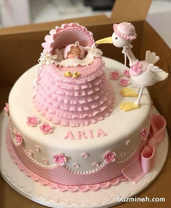 مینی کیک فوندانت جشن بیبی شاور دخترونه با تم لک لک سفید صورتی