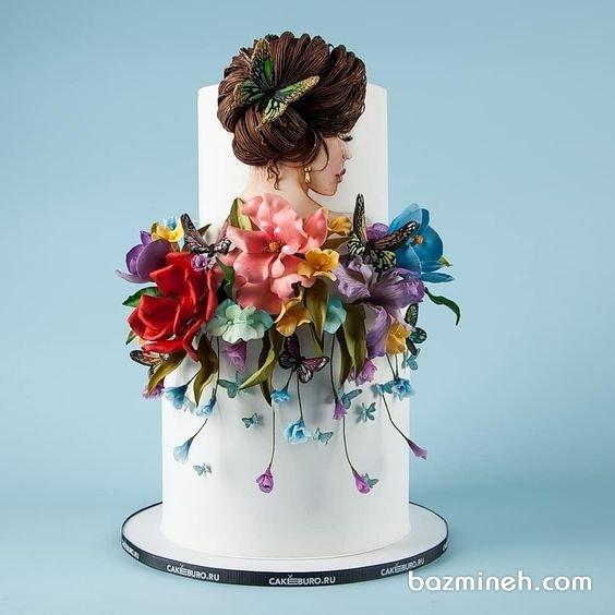 کیک دو طبقه یونیک جشن تولد دخترونه با تزیین گلهای خمیری