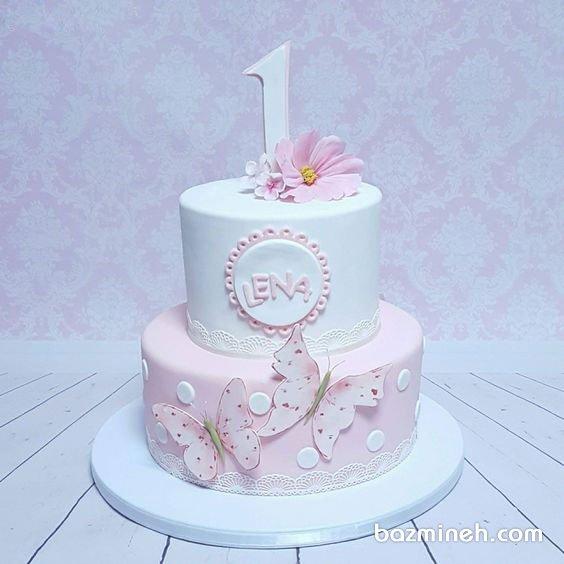 کیک دو طبقه جشن تولد یکسالگی دخترونه با تم سفید صورتی