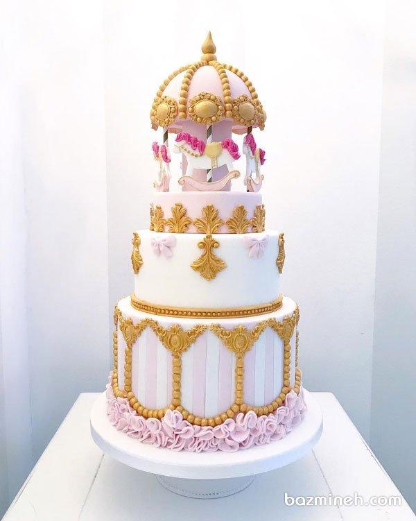کیک چند طبقه فوندانت جشن تولد دخترونه با تم کاروسل (چرخ و فلک اسب دار)