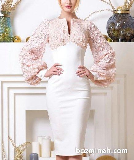 پیراهن جلوبسته پوشیده با پارچه بالا تنه گل برجسته دار و کرپ شیری رنگ و آستینهای پفی ایدهای زیبا برای عروس خانمها در مراسم عقد یا بلهبرون
