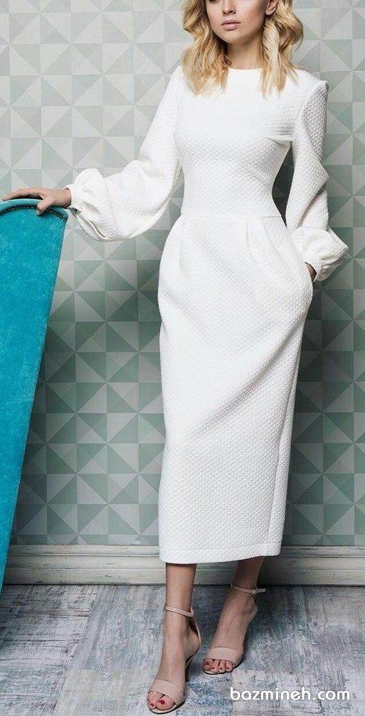 پیراهن جلو بسته ساده و شیک سفید رنگ با آستینهای پفی مناسب برای مراسم عقد محضری و عروس خانمهای ساده پسند