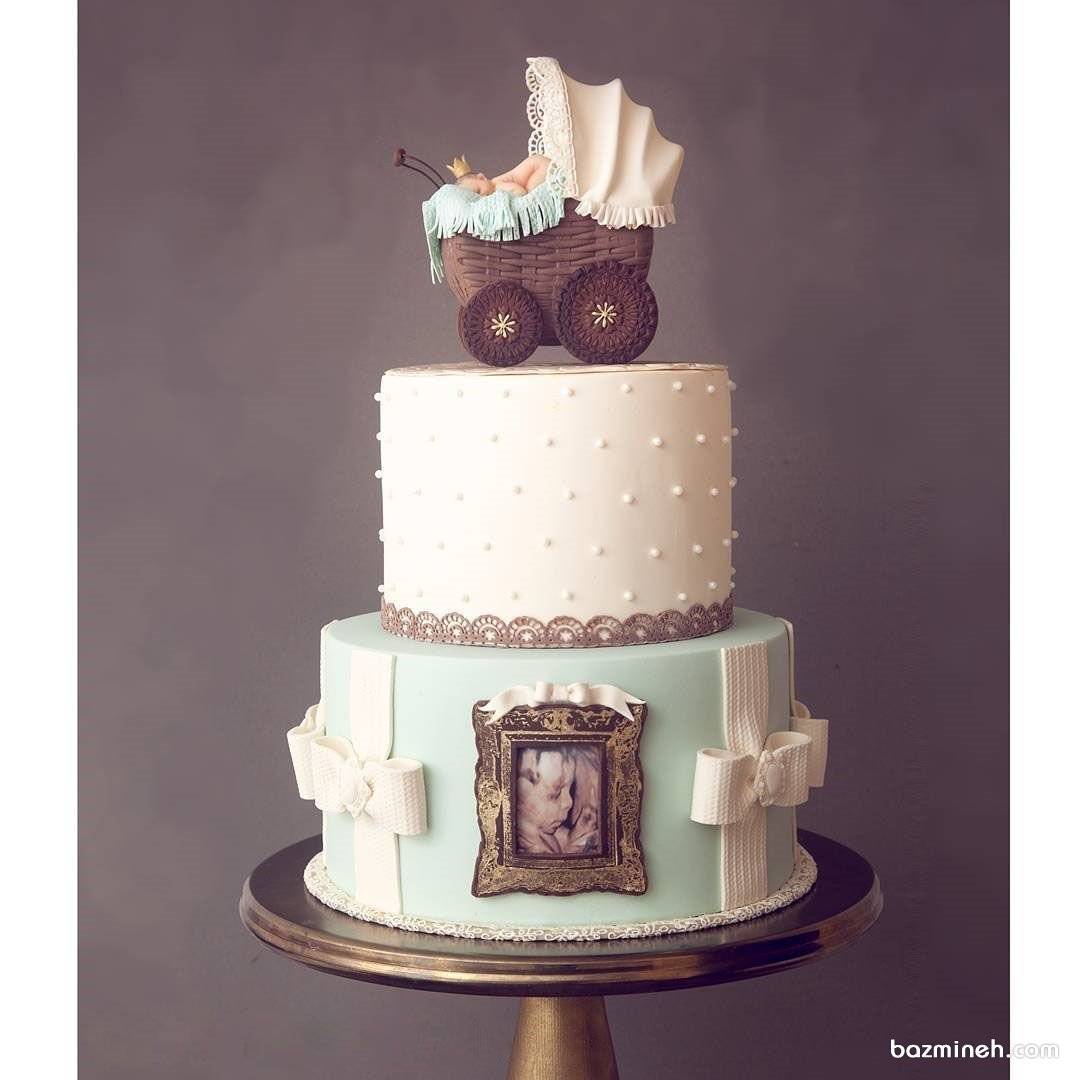 کیک دو طبقه یونیک جشن بیبی شاور یا نوزاد پسرونه با تم کالسکه