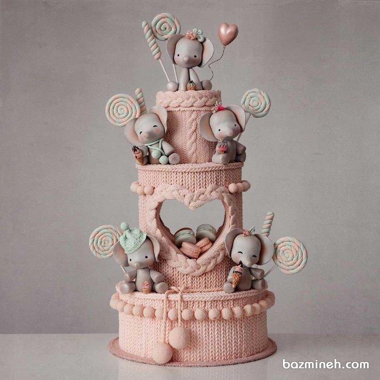 کیک چند طبقه فوندانت جشن تولد کودک با تم زمستونی بافتنی و فیل کوچولو