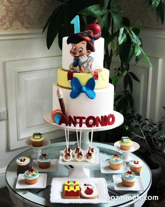 کیک و کاپ کیکهای نوستالژی جشن تولد یکسالگی کودک با تم پینوکیو