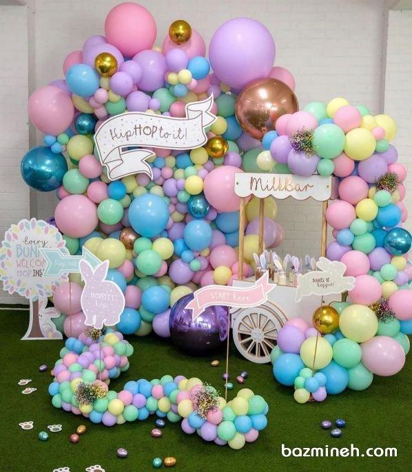 دکوراسیون و بادکنک آرایی جشن تولد کودک با تم رنگهای پاستلی