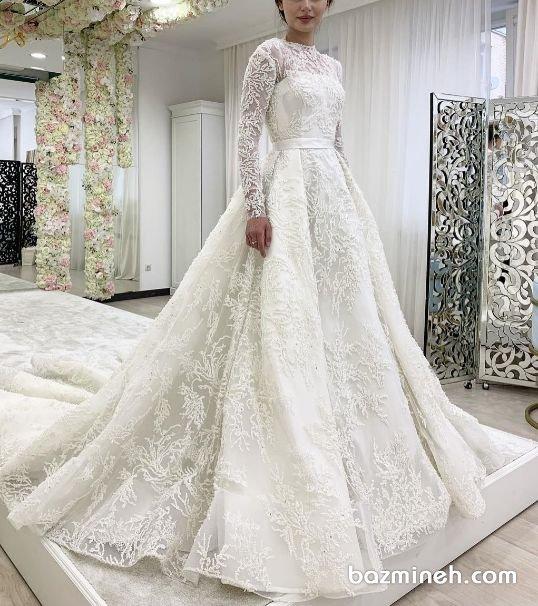 لباس عروس شیک پوشیده آستین دار با دامن پفی کلوش دنبالهدار