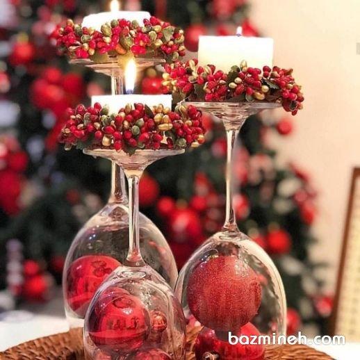 ایده ساده برای تزیین زمستانه در جشن عروسی و نامزدی با شمع آرایی ساده و استفاده از المانهای زیبای زمستانه مانند انار